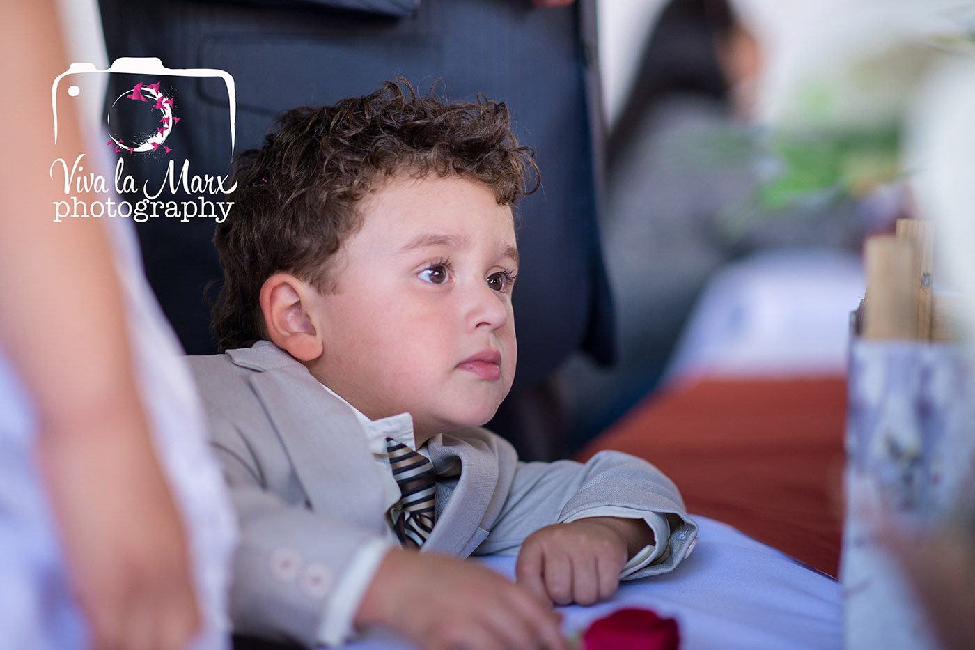 First son, Demetrio, watching a wedding, his parents wedding.