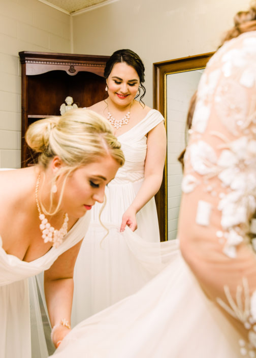 Bridesmaids helping out bride in Houston