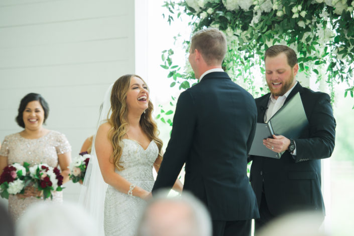 Bride laughing at ceremony at the farmhouse in Houston