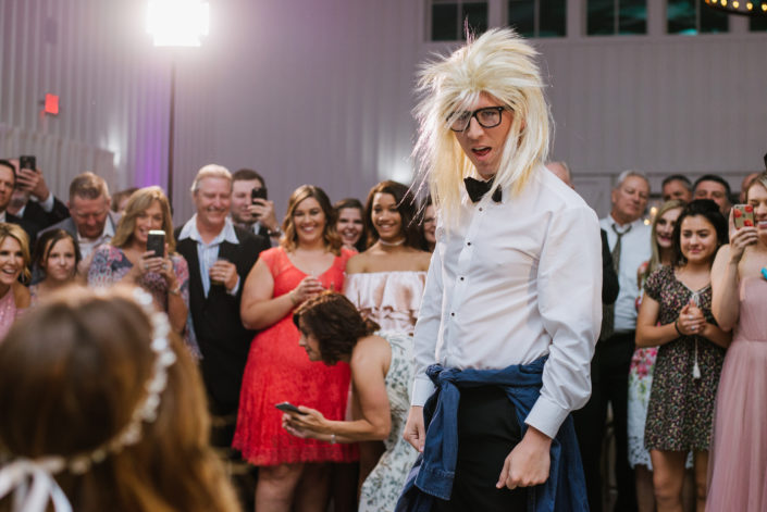 Groom dresses up for garter toss in Houston