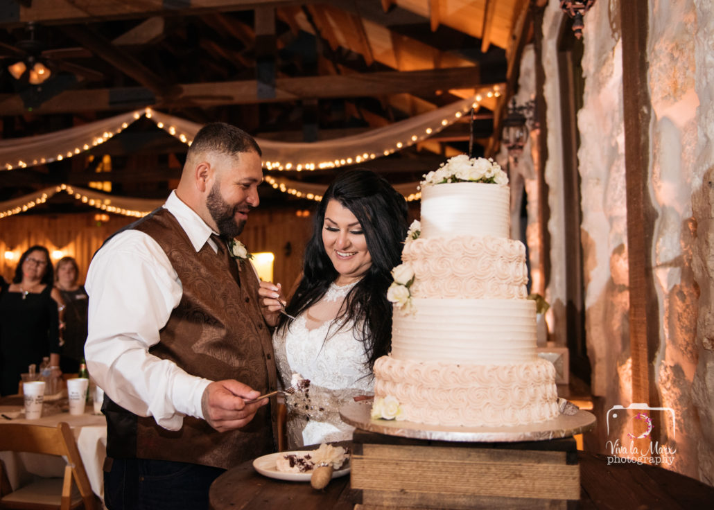 The bride and groom cut the cake at The Springs Event Venue in Angleton