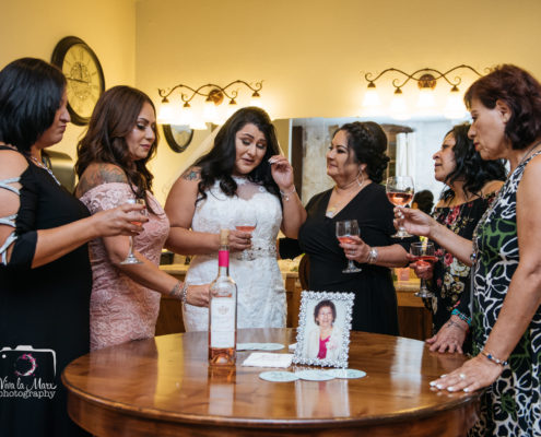 Bride toasting with her sisters in the bridal suite