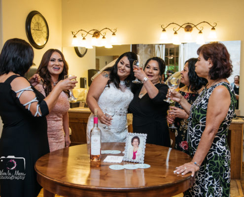 Bride toasting with her sisters on her wedding day