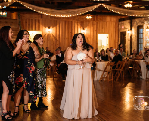 Bridesmaid catches bouquet at The Springs Event Venue
