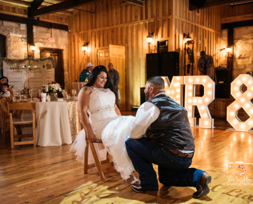 Groom taking garter off at The Springs Event Venue in Angleton, Texas