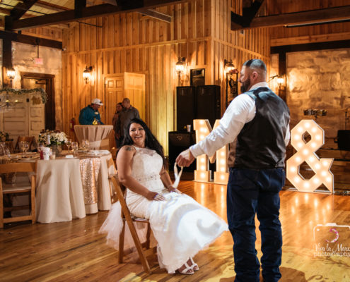 The groom takes garter off at The Springs Events Venue in Angleton, Texas