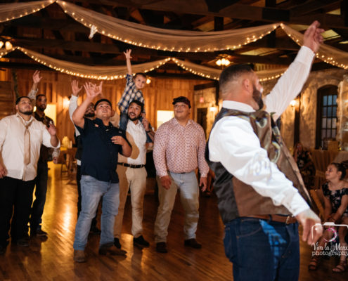 Groom tossing the garter at The Springs Event Venue Angleton