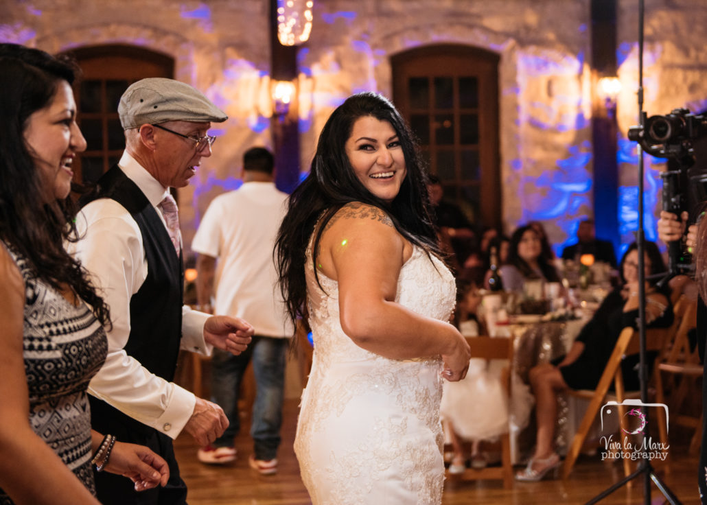 Bride having fun on the dance floor at The Springs Event Venue Angleton