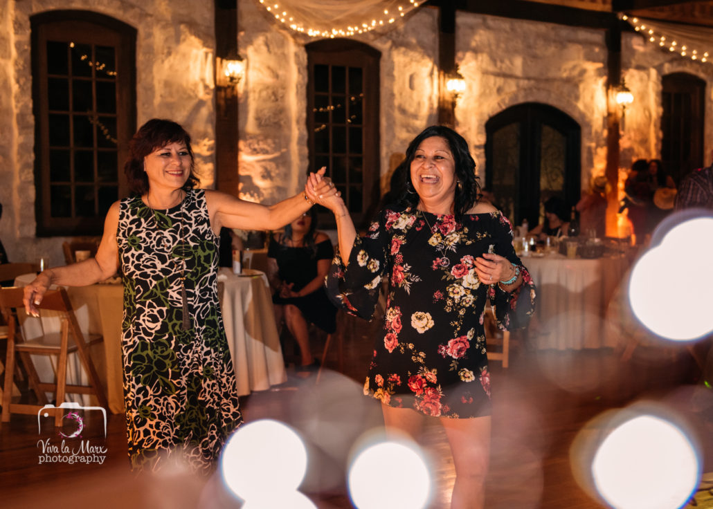 Sisters having fun on the dance floor at The Springs Wedding Venue in Angleton