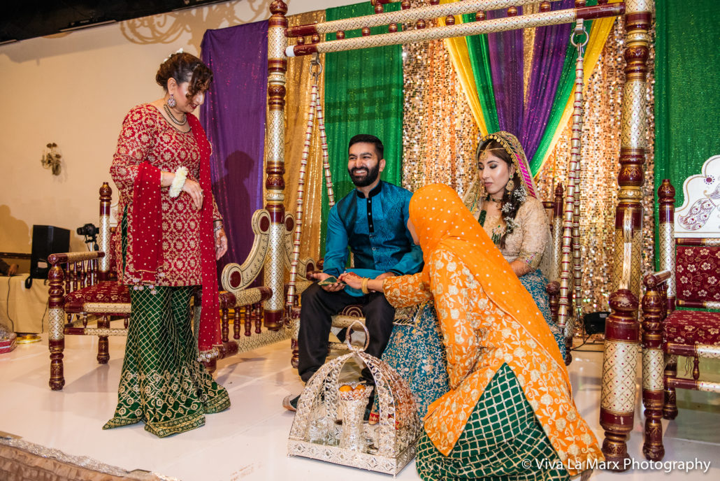 Feeding bride and groom at Houston Pakistani Wedding