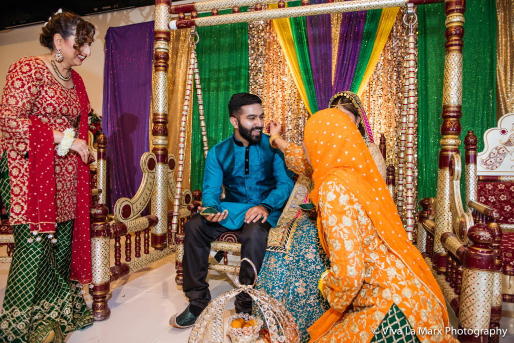 Feeding the groom at Pakistani Houston Wedding