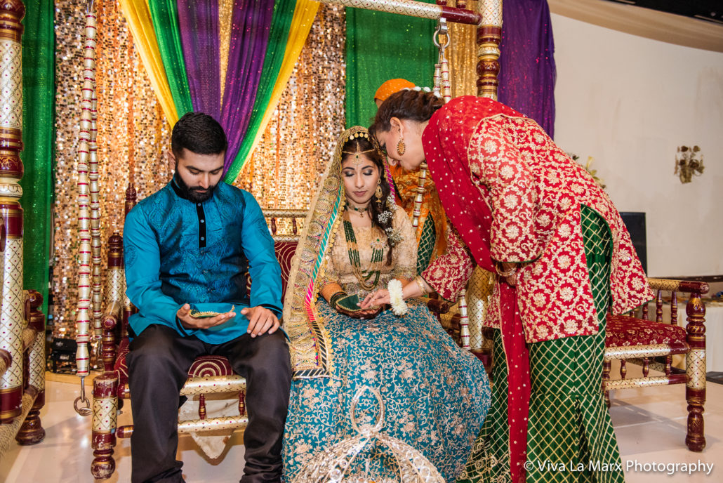 Feeding the wedding couple at Houston Pakistani Wedding