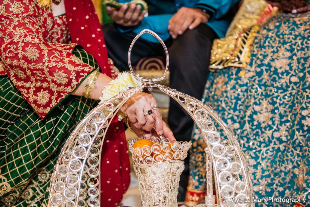 Feeding bride and groom at Houston Pakistani Wedding