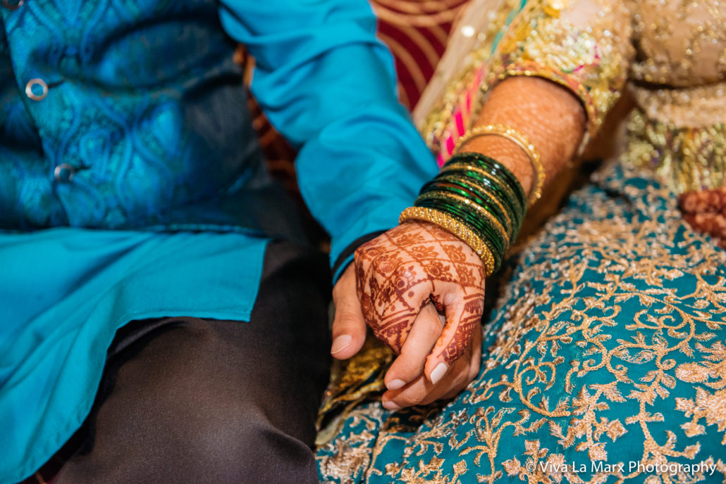 Holding hands at Houston Pakistani Wedding