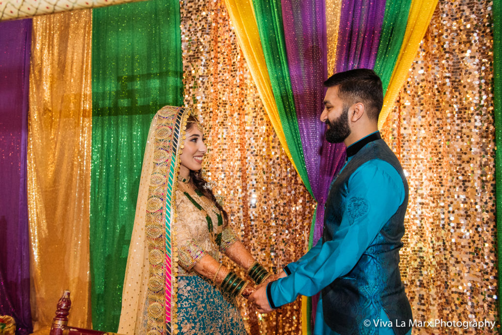 Looking at each other at Houston Pakistani Wedding